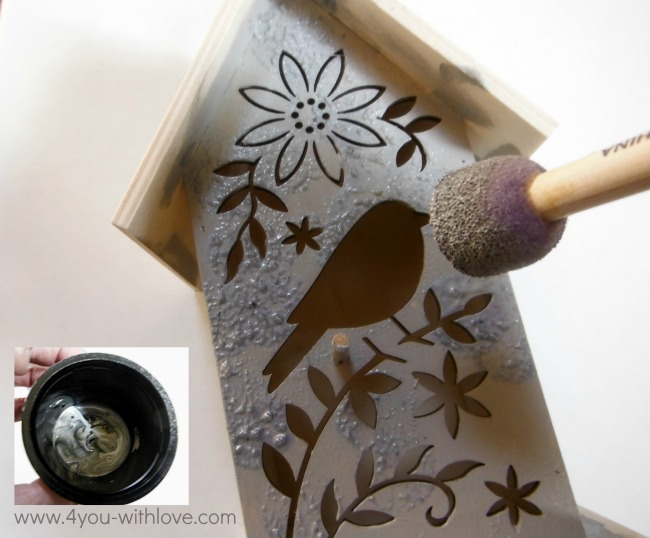 painted birdhouse pounce on grey paint